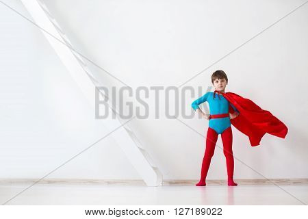 Leader. The Boy Super Hero In A Red Cloak.