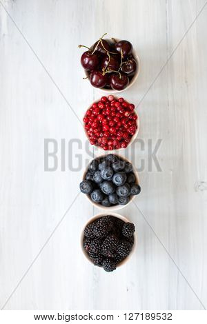 Berries On Wooden Background Flat Lay.