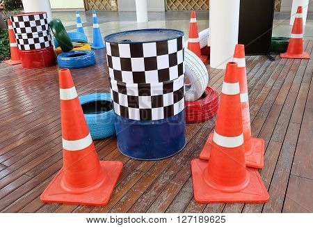 Automotive Safety Concepts Painted Tires with Stripe Traffic Cones and Traffic Barrels.