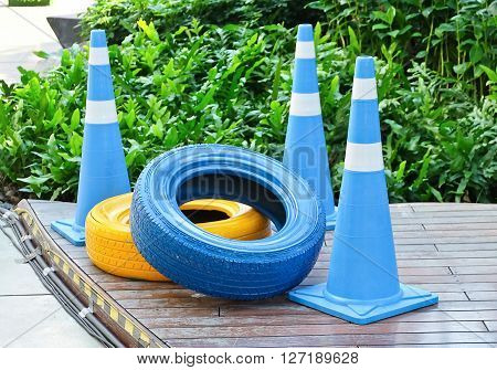 Automotive Safety Concepts Painted Tires with Blue and White Traffic Cones.