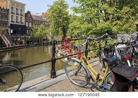 Utrecht, Netherlands - May 6: There are duplex embankments of the city with a cafe at the edge of the canal at a sunny day May 6, 2013 in Utrecht, Netherlands.
