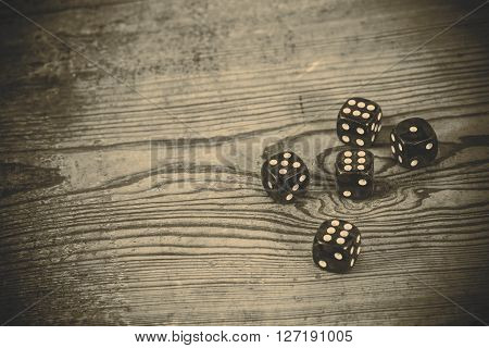 dice on the wooden table - triple six one and five