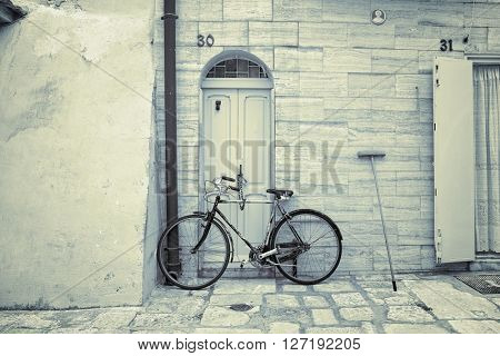 BARI, ITALY - JULY 06, 2015: old bicycle in alleway of Bari Old Town, Italy