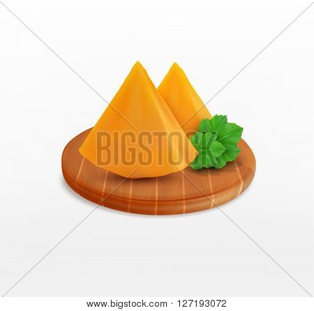 pumpkin slices lying on a wooden cutting board isolated on white background
