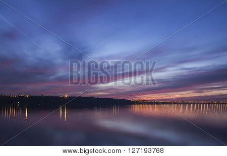 Sunset over Volga River and Presidental Bridge, located in Ulyanovsk. Blue hour photo