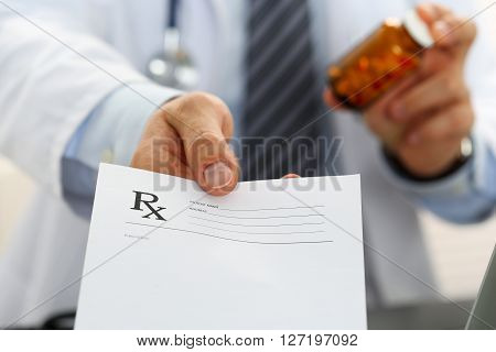Male Medicine Doctor Hand Hold Jar Of Pills