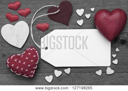 Label With Red Textile Hearts On Wooden Gray Background. Copy Space For Advertisement Or Your Free Text Here. Retro Or Vintage Style. Black And White Image With Colored Hot Spot.