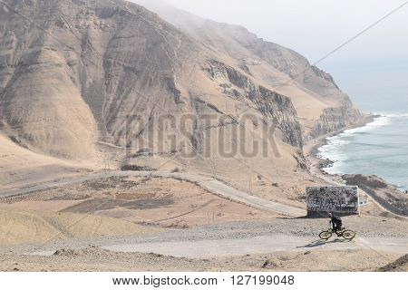 Peruvian Mountain biker hitting the hills on the coastline of Lima, Peru.