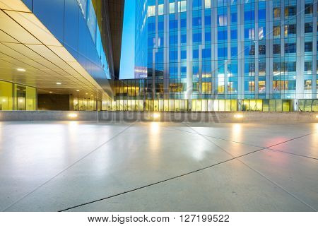 empty marble floor front of modern business buildings in san francisco at night