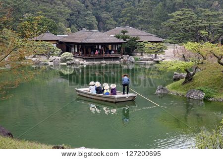 Kagawa, Japan - April 10, 2016 - The small tourist ship of the pond of Riturin Park Garden in Takamatu, Kagawa, Japan on 28th April 2016