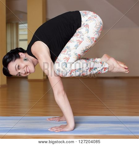 Young  Women Do Yoga Indoors,crane Pose