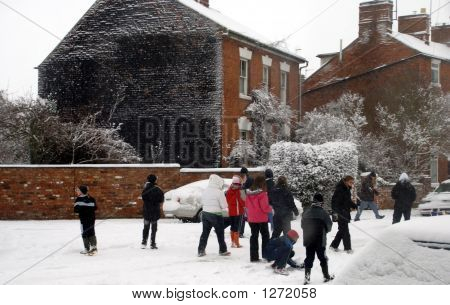 Children Walking In The Street & Playing With The Snow