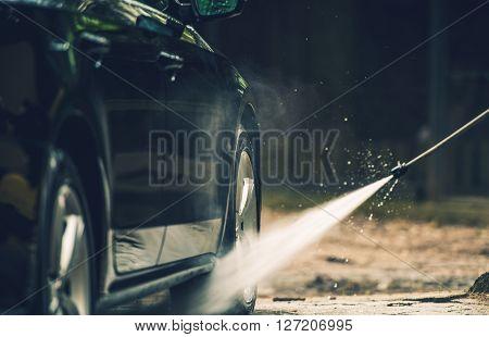 Detailed Car Washing Using Pressured Water Spraying.