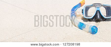 Snorkel and mask on sand