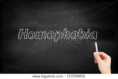 Homophobia written on white blackboard