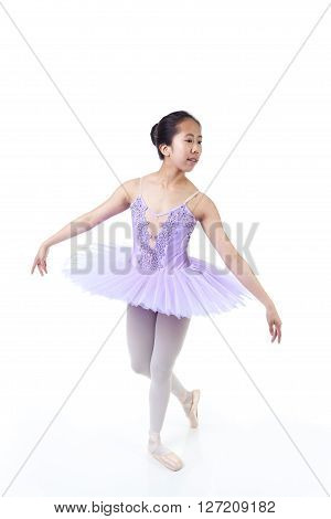 Young Asian Ballerina With Braces In Dance Pose