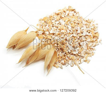 Oat ears of grain and bran isolated on white background