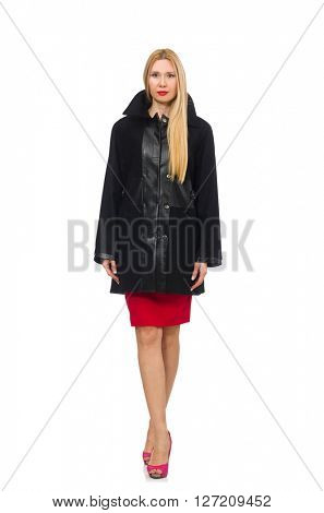 Woman in dress and black coat isolated on white
