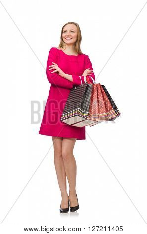 Shopper girl in pink dress holding plastic bags isolated on white