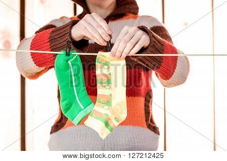 Woman Hanging Socks