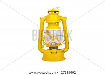 Yellow vintage kerosene lantern isolated on white background