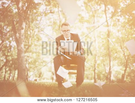 Business Man Sitting Nature Document Concept