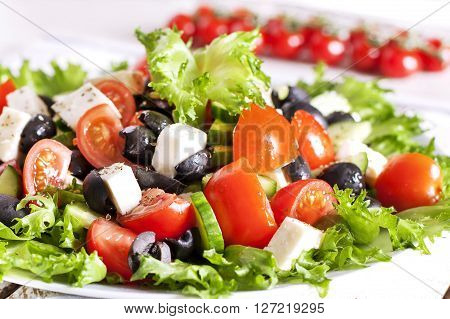 Greek salad  in red boul close - up - Stock image