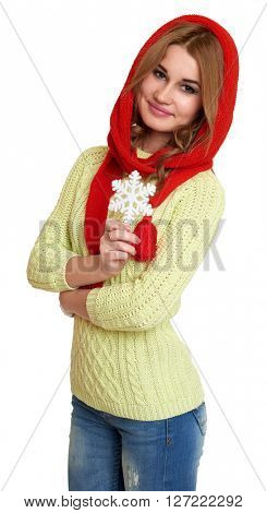 girl dressed red woolen cap and scarf show big snowflake, posing in studio on white background