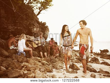 Young people gathering on a beach.