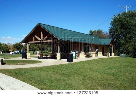 PLAINFIELD, ILLINOIS / UNITED STATES - SEPTEMBER 20, 2015: A picnic shelter and public toilets are available in Plainfield's Settlers' Park.