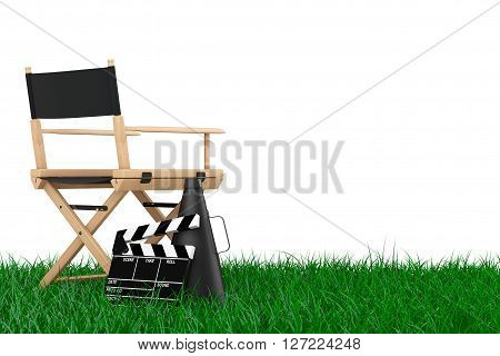 Director Chair Movie Clapper and Megaphone over Grass on a white background. 3d Rendering