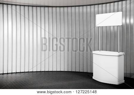 Blank Promotion Stand in front of wall. 3d Rendering
