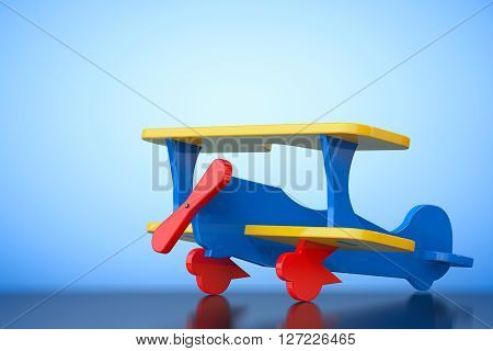 Toy Multicoloured Biplane on a blue background. 3d Rendering