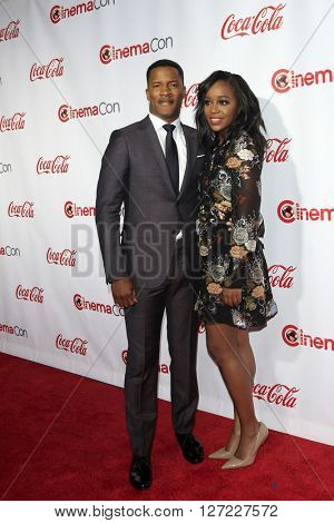 LAS VEGAS - APR 14:  Nate Parker, Aja Naomi King at the CinemaCon Awards Gala at the Caesars Palace on April 14, 2016 in Las Vegas, CA