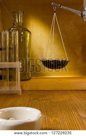 Libra pharmacy and laboratory ware on a wooden background