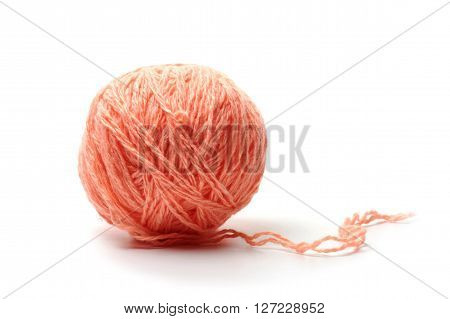 ball of woolen threads of red color isolated on white background
