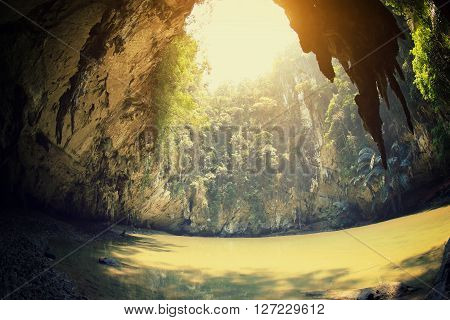 silhouette of stalactite and water in cave