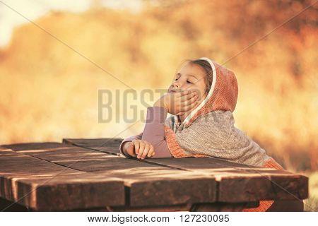 Cute little child enjoying in nature