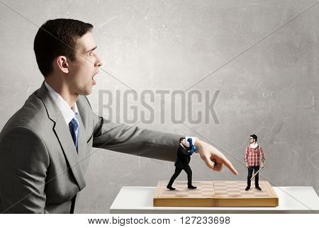 Businessman fighting on the chessboard