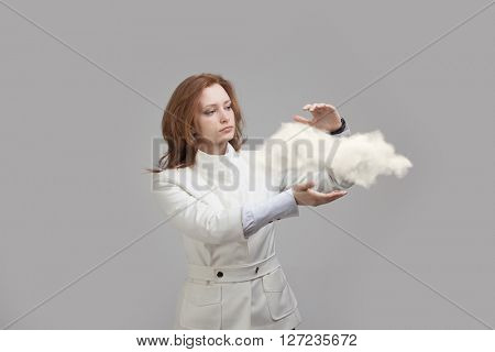 Young woman holding cloud, cloud computing concept