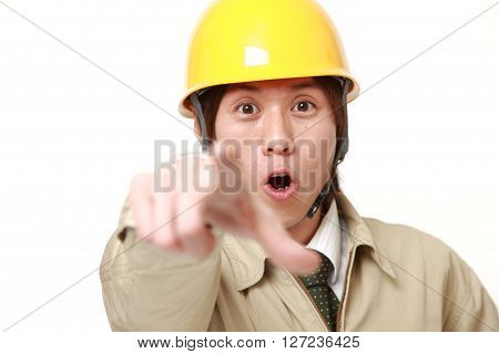 young Japanese construction worker discover something on white background