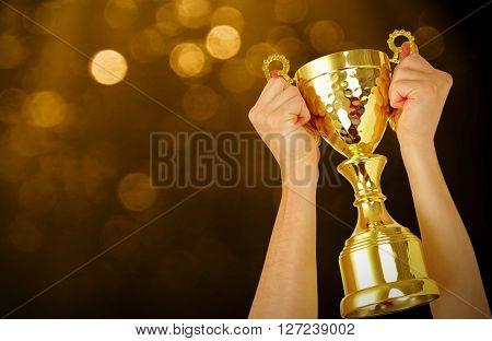 Man holding a champion golden trophy