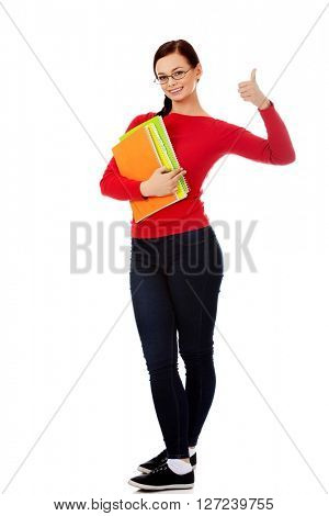 Happy young student woman showing thumbs up