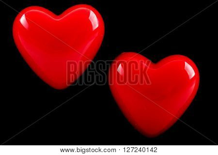 Two reds heart on black background