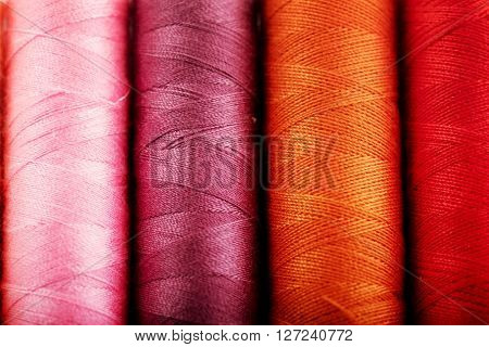 Background of colorful sewing threads