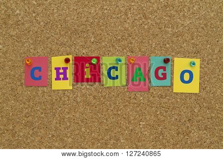 Chicago written on colorful notes pinned on cork board.