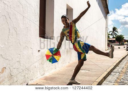 Young Brazilian guy dancing Frevo in Olinda, Brazil