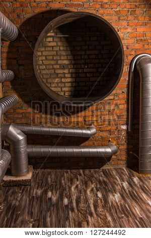 brick wall with a hole and flexible ventilation duct pipe