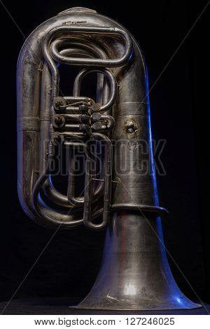 silver tuba isolated on a black background
