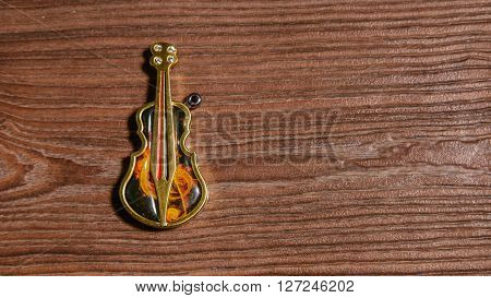 Lighter Keychain bass on a wooden background